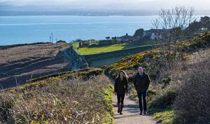 The Duke and Duchess of Cambridge on the cliff walk during a visit to Howth Head in Co. Dublin, as part of their three day visit to the Republic of Ireland. PA Photo;: Brian Lawless/PA Wire