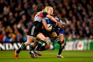 Rhys Ruddock is tackled by Tim Swiel, left, and Matt Hooper during Leinster's Champions Cup clash with Harlequins in which the Irish international suffered an injury