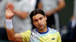 David Ferrer of Spain celebrates after defeating Marin Cilic of Croatia during their men's singles match during the French Open tennis tournament at the Roland Garros stadium in Paris, France, June 1, 2015