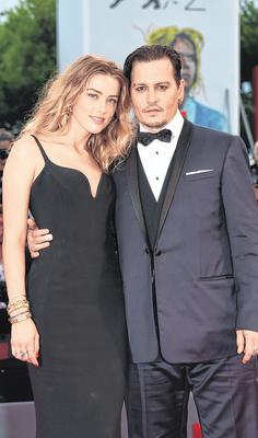 Depp and Heard attend a première during the Venice Film Festival in 2015, nine months before Ms Heard obtained a restraining order against her actor husband