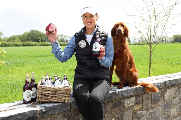 Anne-Marie Feighery and Rinnie with her Beetroot Juice at Feighery's Farm in Kilcormac, Co Offaly. Photo: Alf Harvey