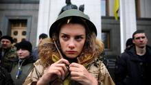 An anti-Yanukovych protester outside Kiev's parliament building