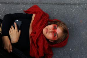 Grounded: A woman lies on the floor during a protest to mark International Women's Day at Zocalo square in Mexico City. Photo: Reuters/Mahe Elipe