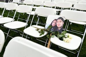 Tribute: A picture of victims of the MH17 crash on empty chairs during a protest outside the Russian Embassy in The Hague. Photo: Reuters/Piroschka van de Wouw
