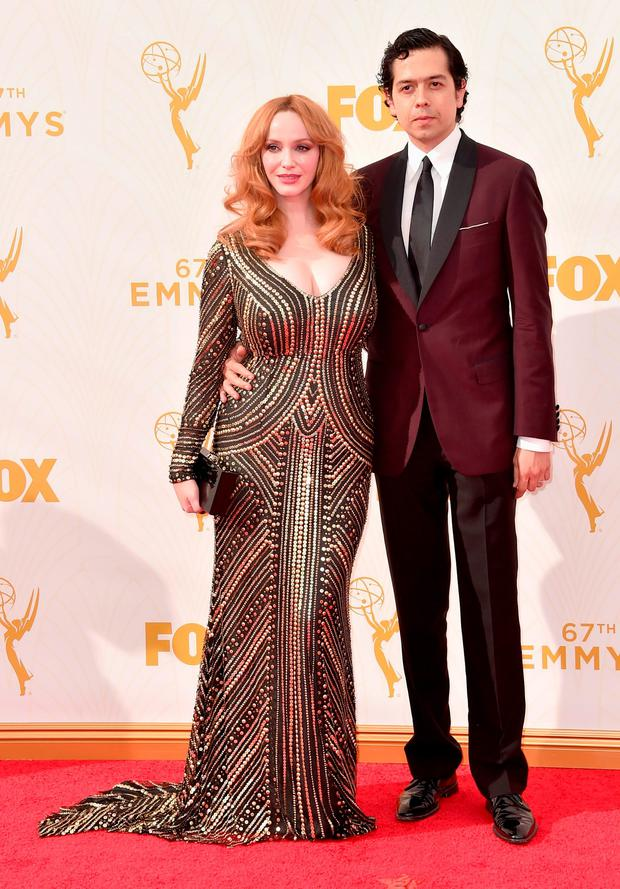 Actress Christina Hendricks (L) and Geoffrey Arend attend the 67th Emmy Awards at Microsoft Theater on September 20, 2015 in Los Angeles, California. 25720_001 (Photo by Alberto E. Rodriguez/Getty Images for TNT LA)