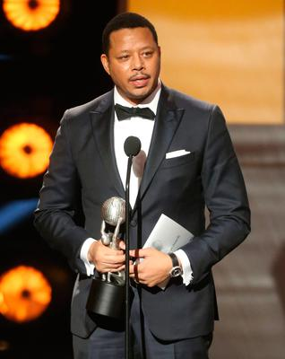 """Actor Terrence Howard accepts award for Outstanding Actor in a Drama Series for """"Empire' onstage during the 47th NAACP Image Awards presented by TV One at Pasadena Civic Auditorium on February 5, 2016 in Pasadena, California.  (Photo by Frederick M. Brown/Getty Images for NAACP Image Awards)"""