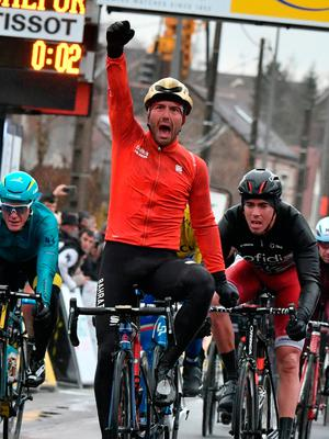 Italy's Sonny Colbrelli celebrates as he crosses the finish line at the end of the 195 km second stage of the 75th edition of the Paris-Nice cycling race. Photo: AFP/Getty