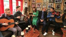(l-r); Padraig O'Dubhghaill, Conor Connolly, Lassa O'Flaherty with her son Danann (3months), Kate Middleton, Prince William and Ronan O'Flaherty in Tig Coli in Galway Picture; Gerry Mooney