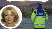 A garda stands at the site near Kerrykeel where officers searched for the body of doctor Deirdre O'Flaherty (inset)