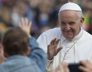 Pope Francis waves as he tours St. Peter's Square at the Vatican in his popemobile prior to his weekly general audience