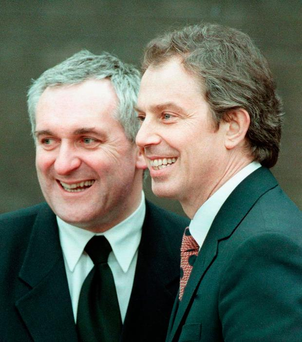 PEACE DEAL: Bertie Ahern and Tony Blair after the signing of the agreement in 1998. Photo: John Giles
