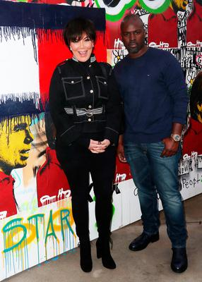 Kris Jenner (L) and Corey Gamble attend Tommy Hilfiger Spring 2017 Women's Runway Show at the Windward Plaza on February 8, 2017 in Venice, California.  (Photo by Frederick M. Brown/Getty Images)