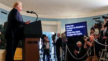 Donald Trump addresses the media in the White House. Photo: REUTERS/Leah Millis