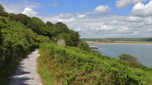 The Ardmore cliff walk, Co Waterford, with St. Declan's hermitage. Photo: Pól Ó Conghaile