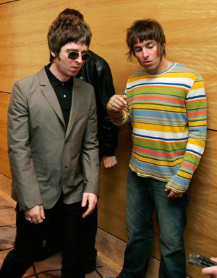 """Noel (L) Gallagher and Liam Gallagher members of the British rock band """"Oasis"""" hold a photocall in Hong Kong 25 February 2006."""