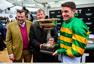 Jockey Barry Geraghty, right, trainer Nicky Henderson, left, and owner JP McManus after winning the Unibet Champion Hurdle Challenge Trophy with Epatante Photo by David Fitzgerald/Sportsfile