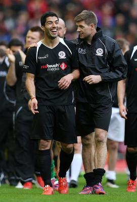 Football - Steven Gerrard All-Stars v Jamie Carragher All-Stars - Liverpool FC Foundation Charity Match - Anfield - 29/3/15 Luis Suarez and Steven Gerrard at the end of the match Action Images via Reuters / Alex Morton Livepic EDITORIAL USE ONLY.