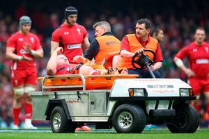 CARDIFF, WALES - MARCH 14: Samson Lee of Wales is stretchered off by medics  during the RBS Six Nations match between Wales and Ireland at the Millennium Stadium on March 14, 2015 in Cardiff, Wales.  (Photo by Michael Steele/Getty Images)
