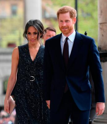 Britain's Prince Harry (R) and his US fiancee Meghan Markle arrive to attend a memorial service at St Martin-in-the-Fields in Trafalgar Square in London, on April 23, 2018