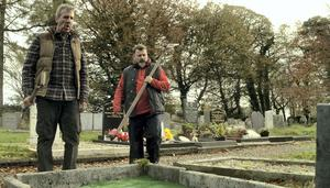 Seamus (Mark Doherty, left) and Martin (Colum McDonnell) do the right thing for their dead pal