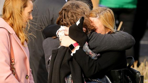 Mourners outside the Church of the Holy family. Picture: Gerry Mooney