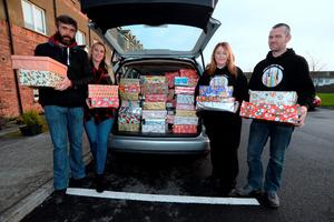 Edel & Bryan Campbell, right, and Naomi White Moroney and Aidan Moroney, from North County Outreach, with car load of 'shoeboxes' - with many personal items inside, to distribute to the homeless. Balbriggan, Co. Dublin. Picture: Caroline Quinn