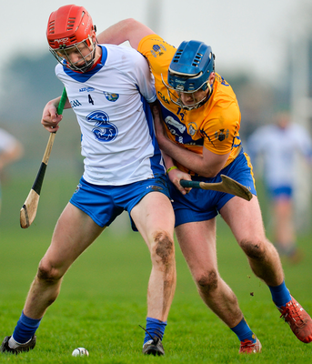 Waterford's Callum Lyons in action against Clare's Bobby Duggan  during the Co-Op Superstores Munster Senior Hurling League match. Photo: Seb Daly/Sportsfile