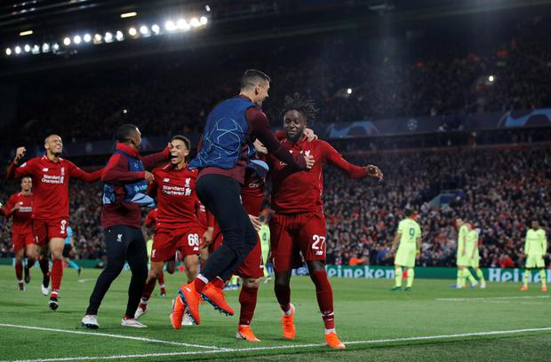 Liverpool's Divock Origi celebrates scoring their fourth goal with Dejan Lovren Trent Alexander Arnold and team mates
