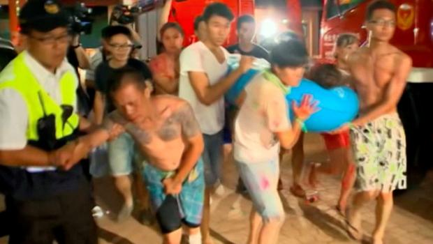 In this screen grab taken from ETTV, injured concert spectators are treated after an accidental explosion during a music concert at the Formosa Water Park in New Taipei City, Taiwan (ETTV via AP)