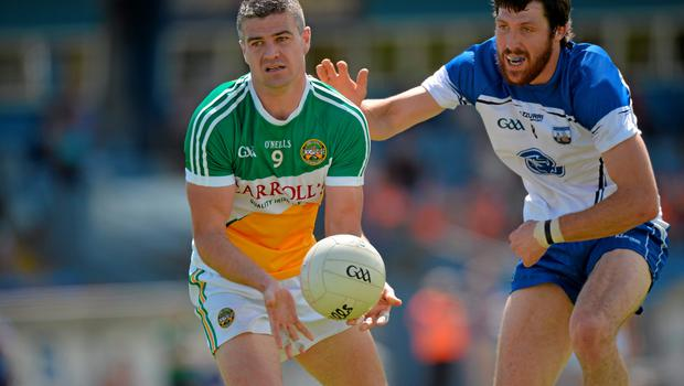 20 June 2015; Niall Smith, Offaly, in action against Tommy Prendergast, Waterford. GAA Football All-Ireland Senior Championship, Round 1A, Waterford v Offaly, Fraher Field, Dungarvan, Co. Waterford. Picture credit: Matt Browne / SPORTSFILE