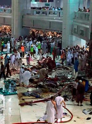 Pilgrims and first responders gather at the site of a crane collapse that killed dozens inside the Grand Mosque in Mecca, Saudi Arabia, Friday, Sept. 11, 2015. The accident happened as pilgrims from around the world converged on the city, Islam's holiest site, for the annual Hajj pilgrimage, which takes place this month. (AP Photo)