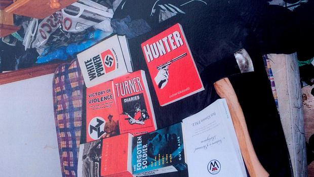 Various associated Nazi literature found during a police search of the home of Zack Davies, 26, from Mold, who was found guilty at Mold Crown Court of attempting to murder Asian dentist Dr Sarandev Bhambra in a racially-motivated attack. Crown Prosecution Service/PA Wireholder.