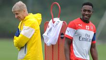 Arsene Wenger with Danny Welbeck during a training session