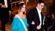 Princess Sofia of Sweden and Swiss astronomer and co-laureate of the 2019 Nobel Prize in Physics Didier Queloz arrive for a royal banquet to honour the laureates of the Nobel Prize 2019 following the Award ceremony on December 10, 2019 in Stockholm, Sweden. (Photo by Jonathan NACKSTRAND / AFP)
