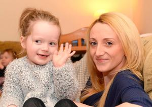 Four-year-old Chloe Ryan with her mum Angela at their home in Dingle, Co Kerry. Chloe's parents are desperate for her to have a drug currently only available for children aged six and over. Photo: Don MacMonagle