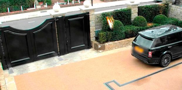 A firebomb being thrown into the front driveway of heiress Petra Ecclestone's home in Chelsea, London Credit: Metropolitan Police/PA Wire