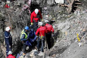 French rescue workers inspect the remains of the Germanwings Airbus A320 at the site of the crash, near Seyne-les-Alpes, French Alps March 29, 2015. REUTERS/Gonzalo Fuentes