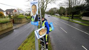 Centre stage: Leo Varadkar posters are put up in Dublin yesterday as the election gets under way.  Picture; Gerry Mooney