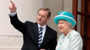 Taoiseach Enda Kenny points  out places of interest to Queen Elizabeth at Government buildings in 2011