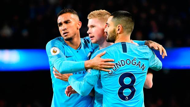 Kevin De Bruyne of Manchester City celebrates with teammates Danilo and Ilkay Gundogan of Manchester City as Conor Coady of Wolverhampton Wanderers (not pictured) scores their team's third goal for an own goal.  Photo: Clive Mason/Getty Images