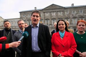 Off-colour: Green Party leader Eamon Ryan with TDs during a Green Party press briefing at Leinster House. Photo: Gareth Chaney/Collins