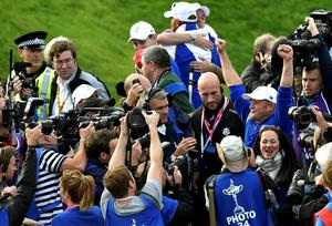 Team Europe golfer Jamie Donaldson (R) raises his arms as he celebrates after winning his match against U.S. player Keegan Bradley to retain the Ryder Cup for Europe on the 15th green during the 40th Ryder Cup at Gleneagles in Scotland September 28, 2014.    REUTERS/Toby Melville (BRITAIN  - Tags: SPORT GOLF)