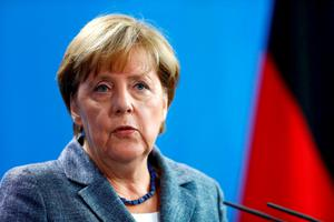 German Chancellor Angela Merkel addresses a news conference at the chancellery in Berlin
