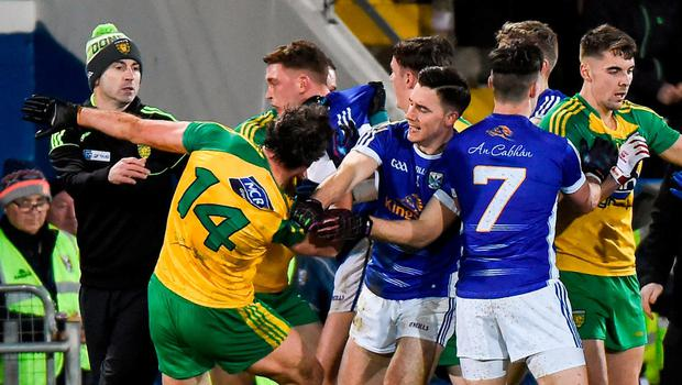 Tempers flare between Donegal and Cavan players close to the sideline in Kingspan Breffni Park on Saturday night. Photo: Matt Browne/Sportsfile