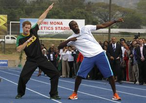 Britain's Prince Harry (L) and Olympic gold medallist Usain Bolt pose at the Usain Bolt track at the University of the West Indies in Kingston, Jamaica March 6, 2012