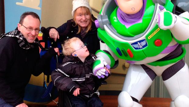 Family handout photo of seven-year-old James Dwerryhouse, with his mother Marguerite and father John at Disneyland, who died after staff at the private Portland Hospital in London switched off vital breathing equipment. Photo: Family handout/PA Wire