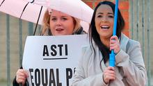 ASTI's Cara Davey (left) and Claire O'Shea protest last year. Photo: Collins