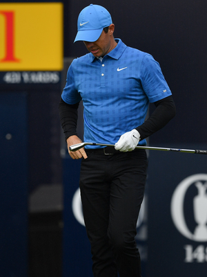 McIlroy walks away from the first tee at The Open last year: 'I put a bit too much right hand in it and it got going on the wind and just out of bounds.' Photo: Brendan Moran.