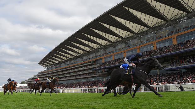 Ryan Moore on Caravaggio (R) wins the Commonwealth Cup on Day Four of Royal Ascot at Ascot Racecourse on June 23, 2017 in Ascot, England. (Photo by Mike Hewitt/Getty Images)