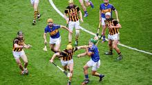 Kilkenny's Colin Fennelly brushes off a challenge from James Woodlock of Tipperary during the All-Ireland hurling final at Croke Park. Photo: Dáire Brennan / SPORTSFILE